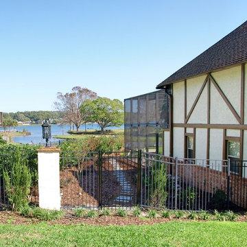 Tudor Revival backyard lakefront landscape design