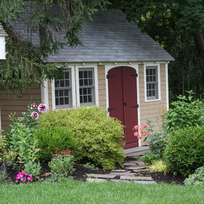 Photo of a large traditional full sun backyard stone landscaping in Boston for summer.