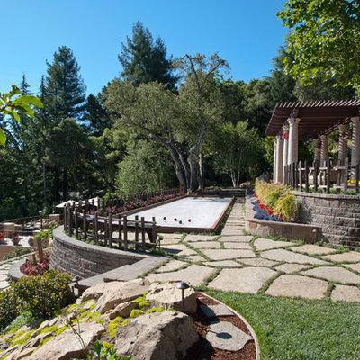 Design ideas for a mediterranean hillside stone landscaping in San Francisco.