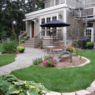 Inspiration for a mid-sized traditional full sun backyard stone garden path in Minneapolis.