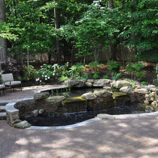 Traditional Landscape by Clearwater Landscape & Nursery