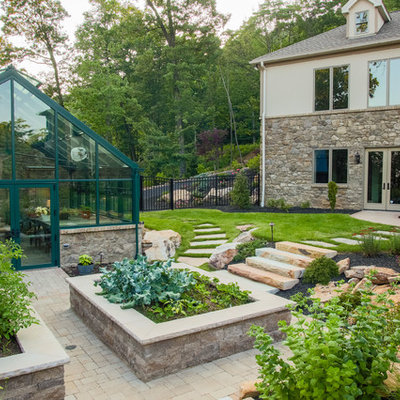 This is an example of a traditional full sun backyard vegetable garden landscape in Other.