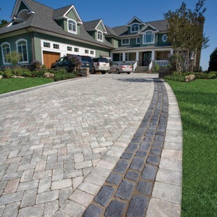 This is an example of a contemporary front yard concrete paver driveway in Other.