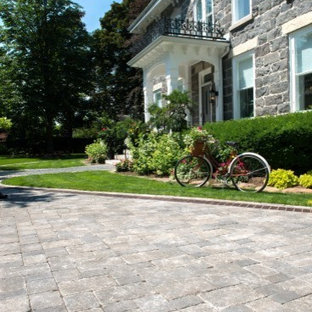 Design ideas for a contemporary front yard concrete paver driveway in Other.