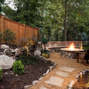 Design ideas for a rustic full sun backyard gravel landscaping in Atlanta with a fire pit.