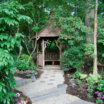 This is an example of a rustic shade backyard landscaping in Philadelphia.