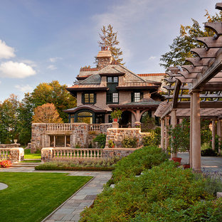 Inspiration for a huge victorian courtyard stone landscaping in New York.