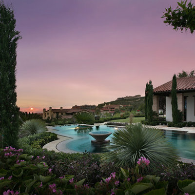 This is an example of a large mediterranean full sun backyard landscaping in Los Angeles.