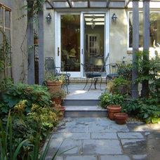 Traditional Landscape by Plusen Landscape Architects