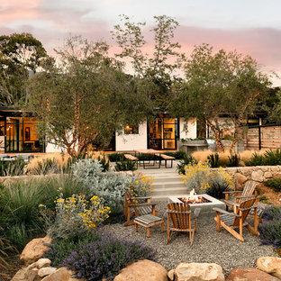 Photo of a large midcentury modern full sun backyard concrete paver garden path in Santa Barbara.