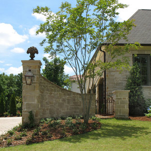 Inspiration for a mid-sized traditional front yard stone driveway in Little Rock.