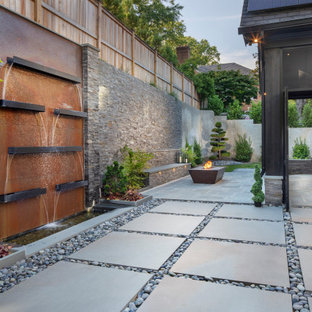 This is an example of a contemporary partial sun backyard stone landscaping in DC Metro for summer.