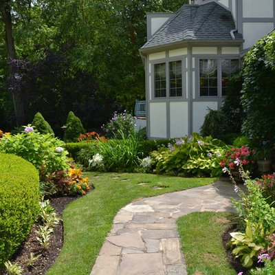 Photo of a traditional backyard landscaping in New York.