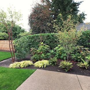 Photo of a farmhouse backyard landscaping in Portland.