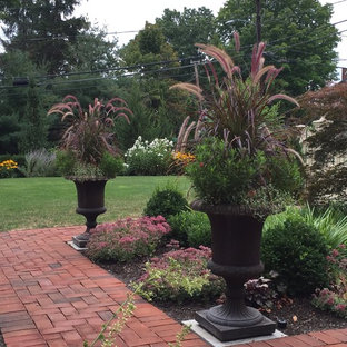 Inspiration for a mid-sized victorian full sun front yard brick formal garden in Boston for summer.