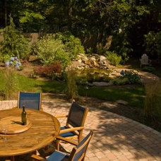 Eclectic Landscape by A Yard & A Half Landscaping Cooperative, Inc.