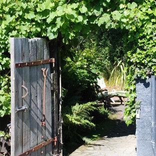 Design ideas for a rustic backyard stone garden path.