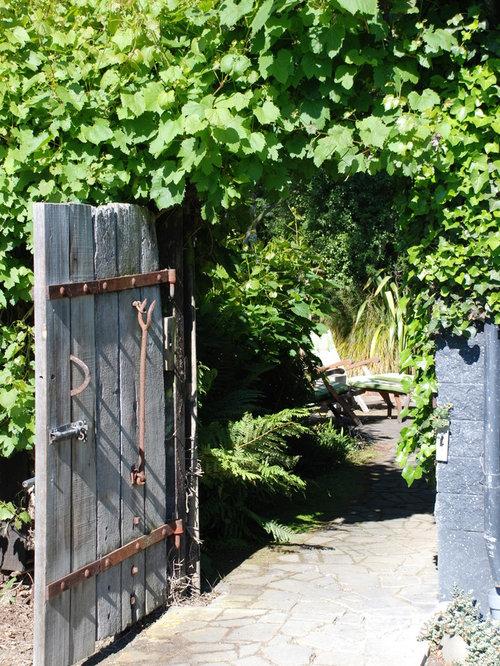 Design Ideas For A Rustic Backyard Stone Garden Path In Wellington.