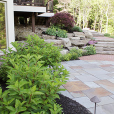 Traditional Landscape by Exscape Designs