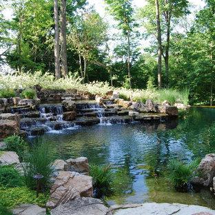 Foto de jardín clásico con estanque
