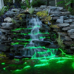 Design ideas for a mid-sized stone water fountain landscape in New York.