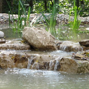 Design ideas for a huge rustic partial sun backyard mulch pond in Other for summer.