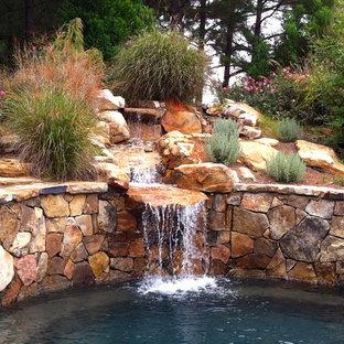Design ideas for a traditional hillside water fountain landscape in Atlanta.