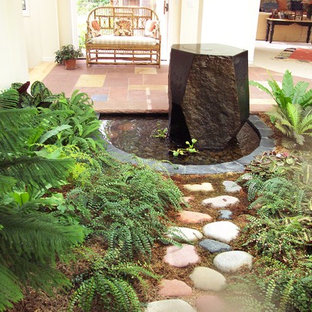 This is an example of a partial sun stone water fountain landscape in Denver.