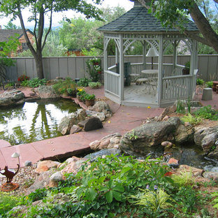 This is an example of a transitional stone water fountain landscape in Denver for summer.