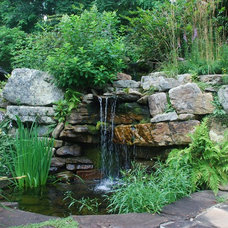 Rustic Landscape by Snow Creek Landscaping, LLC