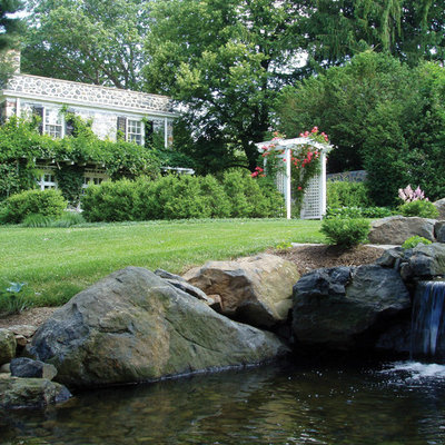 Inspiration for a mid-sized traditional partial sun courtyard stone landscaping in Philadelphia.