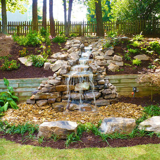Design ideas for a traditional backyard water fountain landscape in Atlanta.