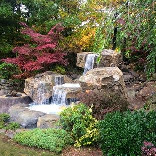 Ispirazione per un grande giardino tropicale con fontane