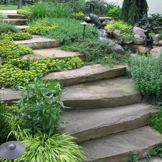Traditional Landscape by Runde's Landscape Contractors, Inc.