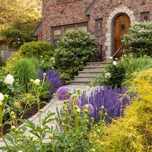 This is an example of a traditional full sun front yard concrete paver garden path in Boston.