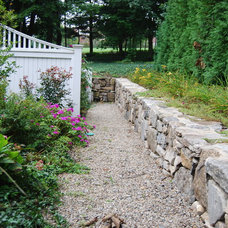 Traditional Landscape by Watertown Landscaping, Inc.