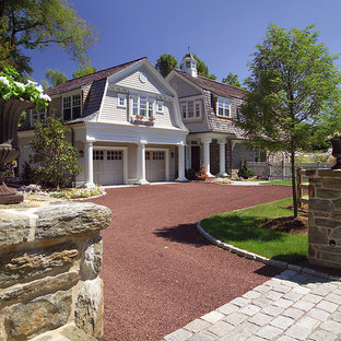 This is an example of a mid-sized victorian full sun front yard gravel driveway in Philadelphia.