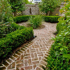 Traditional Landscape by WaterMark Coastal Homes, LLC