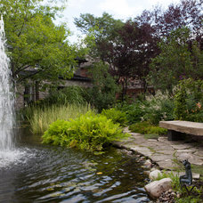 Contemporary Landscape by Yards Unlimited Landscaping Inc.