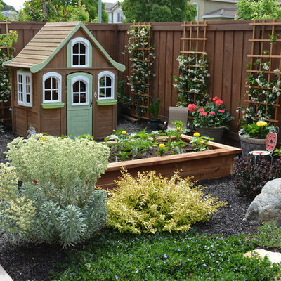 Photo of a small shabby-chic style drought-tolerant and partial sun backyard concrete paver outdoor playset in Sacramento for spring.