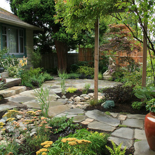 Design ideas for an asian partial sun stone landscaping in Seattle.