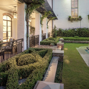 Photo of a large traditional full sun backyard stone landscaping in Houston.