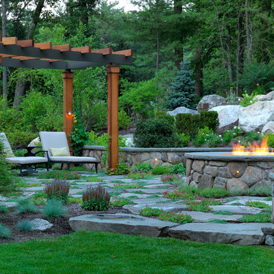 Design ideas for a large traditional backyard stone landscaping in Boston with a fire pit.