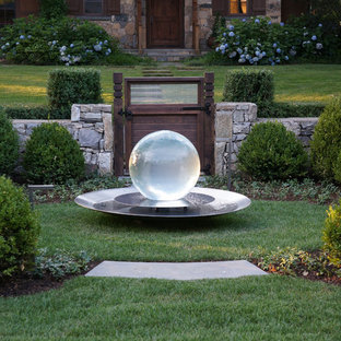 This is an example of a traditional backyard water fountain landscape in New York.