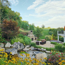 Traditional Landscape by SURROUNDS Landscape Architecture + Construction