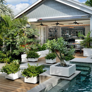 Photo of a large beach style landscaping in Miami.