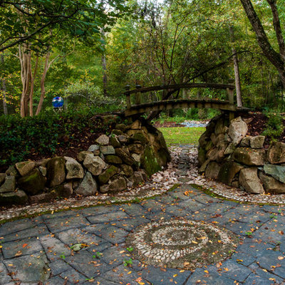 Photo of a traditional rock backyard stone landscaping in Raleigh.