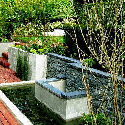 Photo of a contemporary retaining wall landscape in Vancouver.