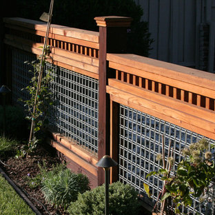 This is an example of a large craftsman full sun backyard mulch landscaping in San Francisco for spring.