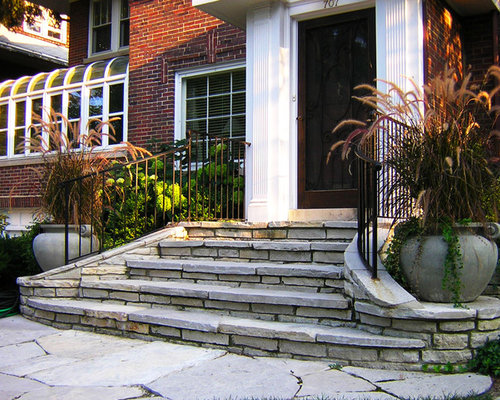 design ideas for a traditional front yard landscape in chicago with natural stone pavers
